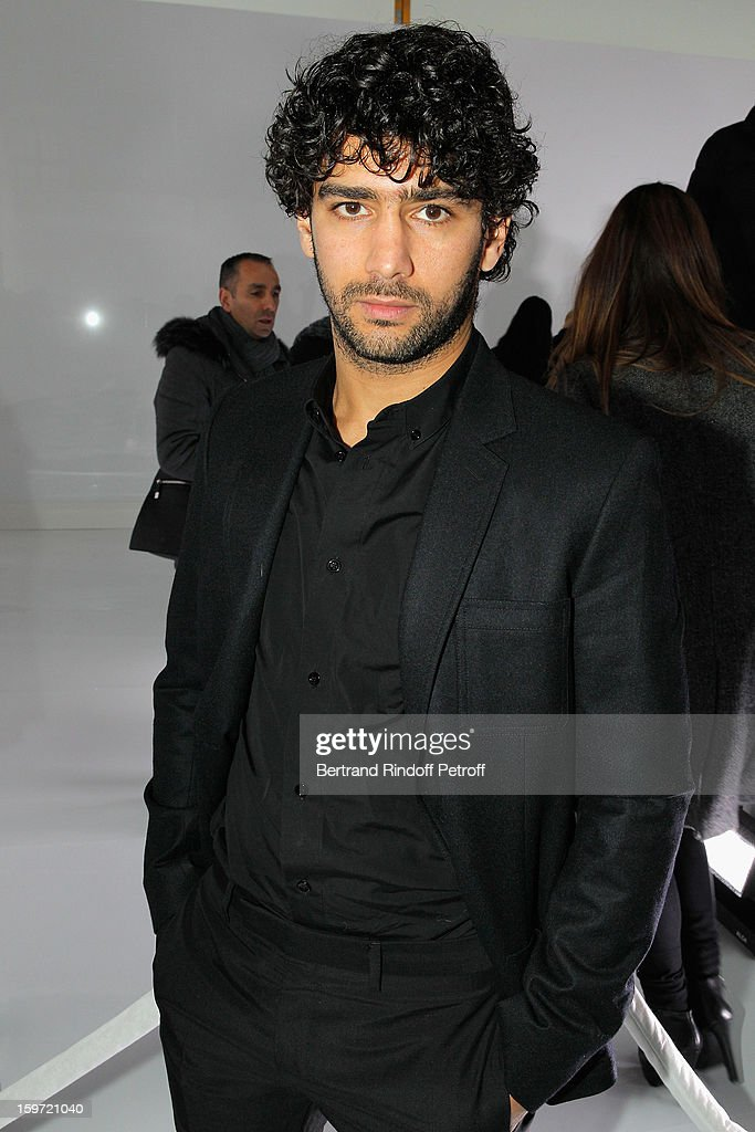 Actor Salim Kechiouche attends the Dior Homme Men Autumn / Winter 2013 show as part of Paris Fashion Week, at Quartier des Celestins, on January 19, 2013 in Paris, France.