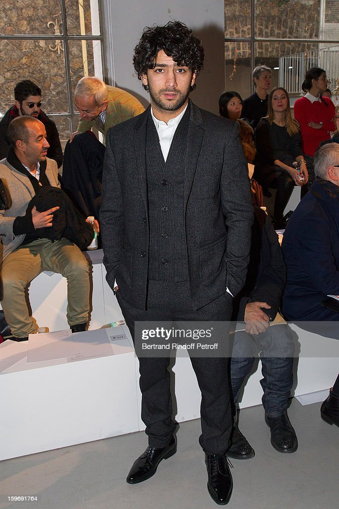 Actor Salim Kechiouche attends the Krisvanassche Men Autumn / Winter 2013 show as part of Paris Fashion Week on January 18, 2013 in Paris, France.