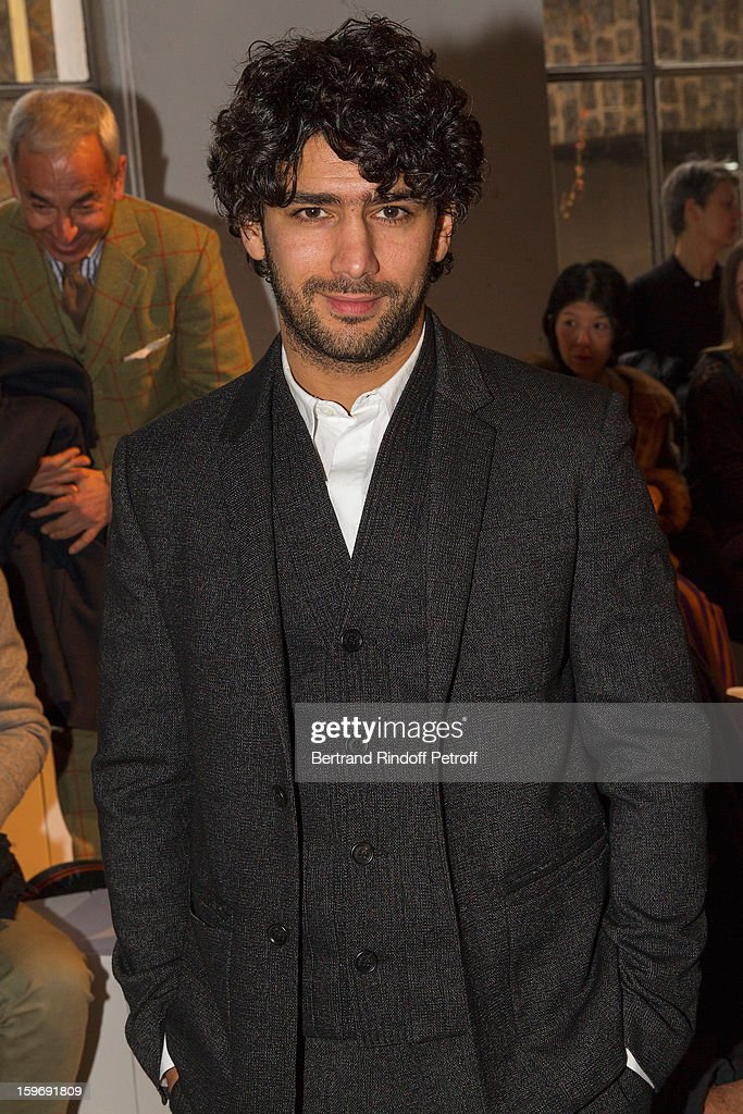 Actor Salim Kechiouche attends the Krisvanassche Men Autumn / Winter 2013 show as part of Paris Fashion Week on January 18, 2013 in Paris, France.