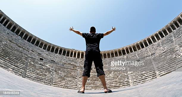 Actor saluting to Amphitheater