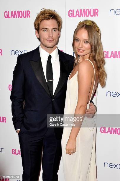 Actor Sam Claflin and Laura Haddock attend the Glamour Women of the Year Awards at Berkeley Square Gardens on June 3 2014 in London England