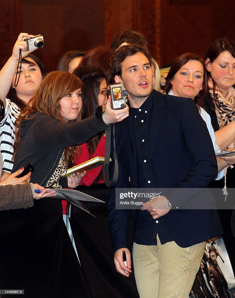Actor <a gi-track='captionPersonalityLinkClicked' href=/galleries/search?phrase=Sam+Claflin&family=editorial&specificpeople=7238693 ng-click='$event.stopPropagation()'>Sam Claflin</a> (C) is photographed with fans at the 'Snow White And The Huntsman' photocall at Ritz Carlton Hotel on May 16, 2012 in Berlin, Germany.