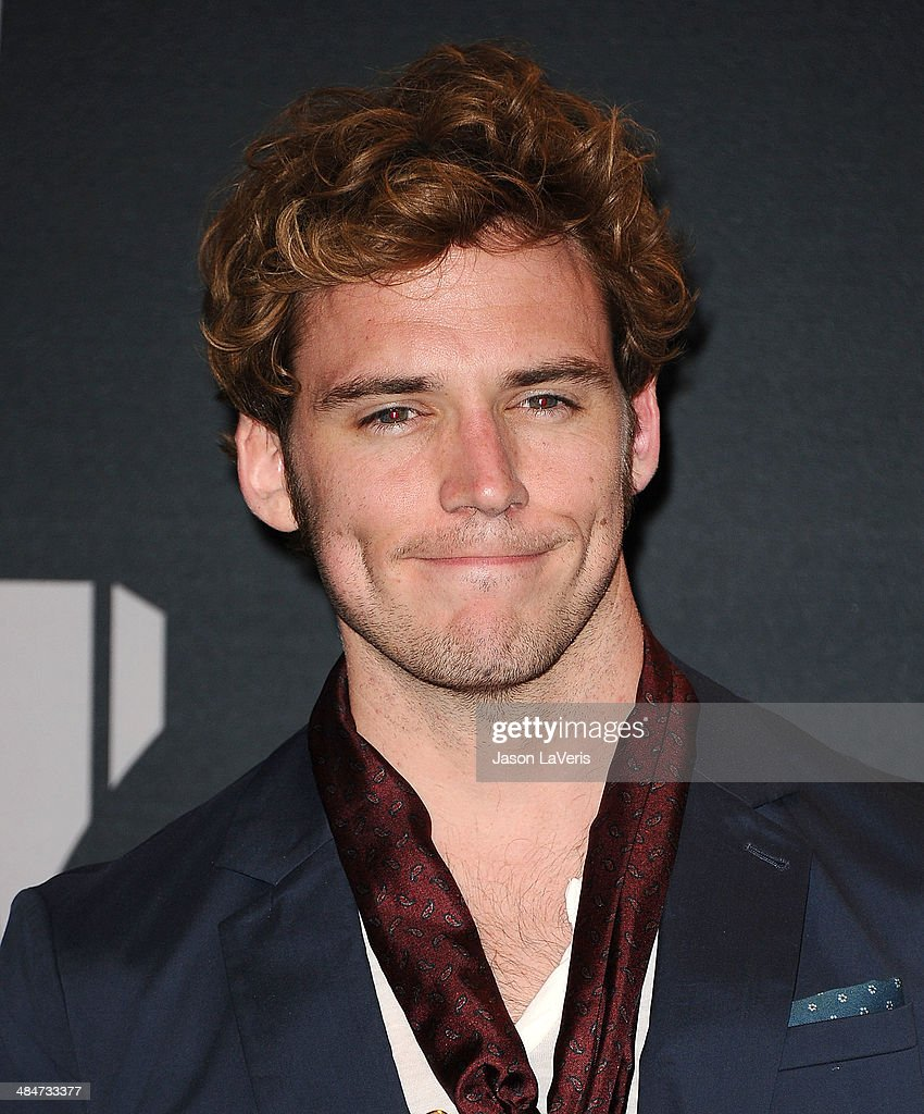 Actor <a gi-track='captionPersonalityLinkClicked' href=/galleries/search?phrase=Sam+Claflin&family=editorial&specificpeople=7238693 ng-click='$event.stopPropagation()'>Sam Claflin</a> poses in the press room at the 2014 MTV Movie Awards at Nokia Theatre L.A. Live on April 13, 2014 in Los Angeles, California.
