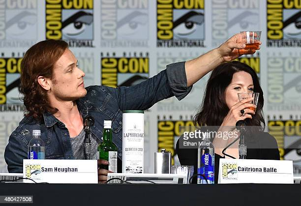 Actor Sam Heughan and actress Caitriona Balfe attend the Starz 'Outlander' panel during ComicCon International 2015 at the San Diego Convention...