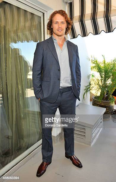 Actor Sam Heughan wearing Burberry at Eddie Redmayne Vanity Fair And Burberry Celebrate BAFTA Los Angeles and the Britannia Awards at Chateau Marmont...