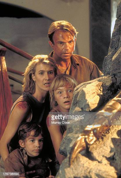 Actor Sam Neill as Dr Alan Grant and actress Laura Dern as Dr Ellie Sattler with Ariana Richards and Joseph Mazzello as Lex and Tim in a scene from...