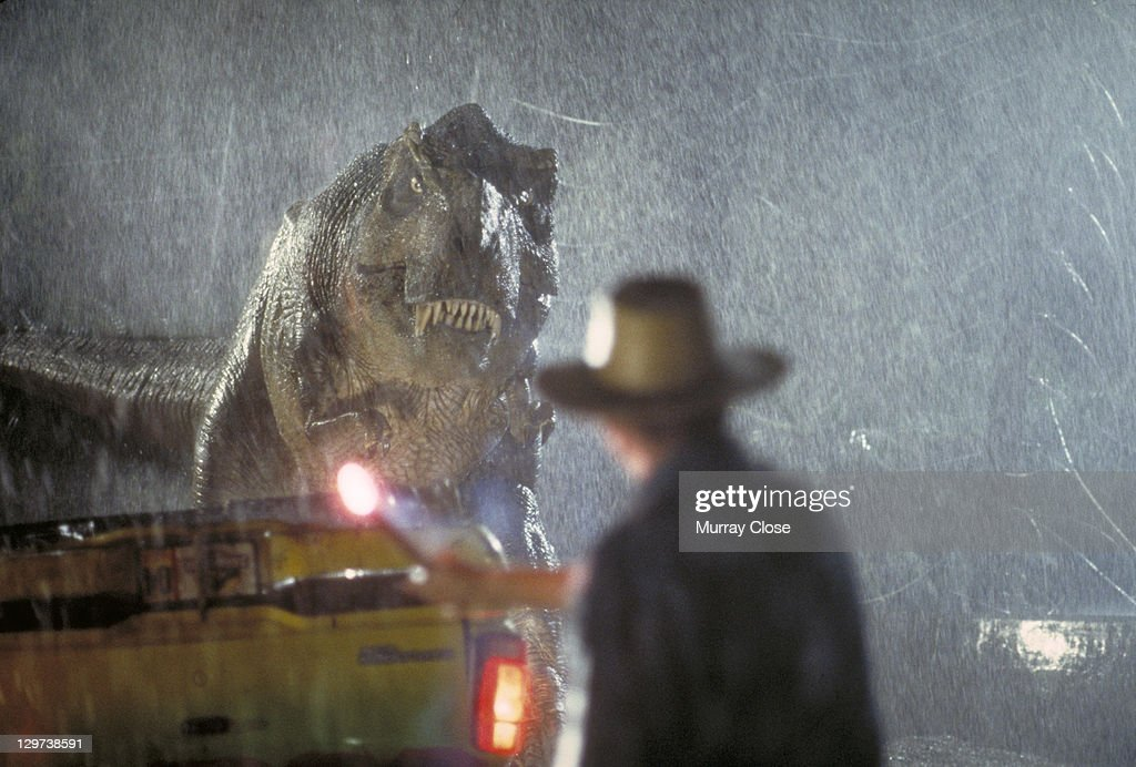 Actor <a gi-track='captionPersonalityLinkClicked' href=/galleries/search?phrase=Sam+Neill&family=editorial&specificpeople=239029 ng-click='$event.stopPropagation()'>Sam Neill</a> as Dr. Alan Grant takes on a Tyrannosaurus Rex in a scene from the film 'Jurassic Park', 1993.