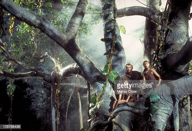 Actor Sam Neill as Dr Alan Grant with Ariana Richards and Joseph Mazzello as Lex and Tim in a scene from the film 'Jurassic Park' 1993