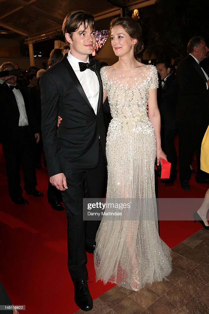 Actor Sam Riley and wife <a gi-track='captionPersonalityLinkClicked' href=/galleries/search?phrase=Alexandra+Maria+Lara&family=editorial&specificpeople=208220 ng-click='$event.stopPropagation()'>Alexandra Maria Lara</a> depart the 'On The Road' Premiere during the 65th Annual Cannes Film Festival at Palais des Festivals on May 23, 2012 in Cannes, France.