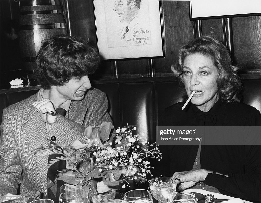 Actor Sam Robards playfully wields a fork at his mother actress Lauren Bacall, because she is smoking during dinner at Chasens restaurant during a reception for the opening of 'Evita' on January 13 1980 in Beverly Hills, California.