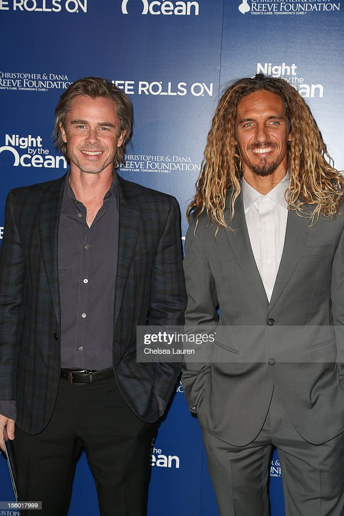 Actor <a gi-track='captionPersonalityLinkClicked' href=/galleries/search?phrase=Sam+Trammell&family=editorial&specificpeople=3205930 ng-click='$event.stopPropagation()'>Sam Trammell</a> (L) and professional surfer Rob Machado arrive at the Life Rolls On foundation's 9th annual 'Night by the Ocean' gala at Ritz Carlton Hotel on November 10, 2012 in Marina del Rey, California.