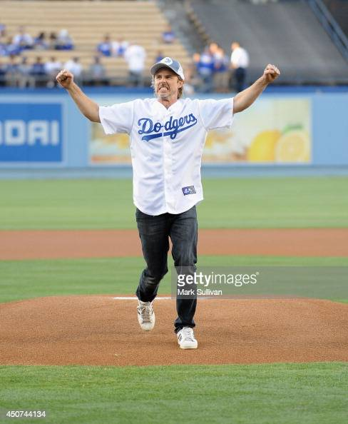 Actor Sam Trammell throws out the ceremonial first pitch before the game between the Colorado Rockies and Los Angeles Dodgers at Dodger Stadium on...