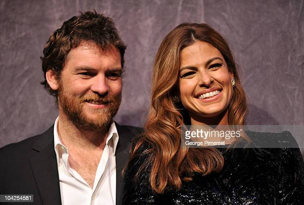 Actor Sam Worthington and actress Eva Mendes onstage at 'Last Night' Premiere introduction during the 35th Toronto International Film Festival at Roy...