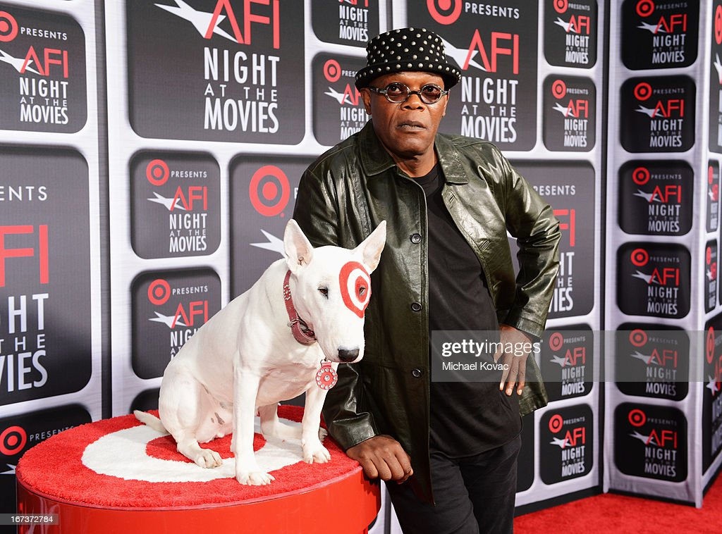 Actor <a gi-track='captionPersonalityLinkClicked' href=/galleries/search?phrase=Samuel+L.+Jackson&family=editorial&specificpeople=167234 ng-click='$event.stopPropagation()'>Samuel L. Jackson</a> (R) and Bullseye on the red carpet for Target Presents AFI's Night at the Movies at ArcLight Cinemas on April 24, 2013 in Hollywood, California.