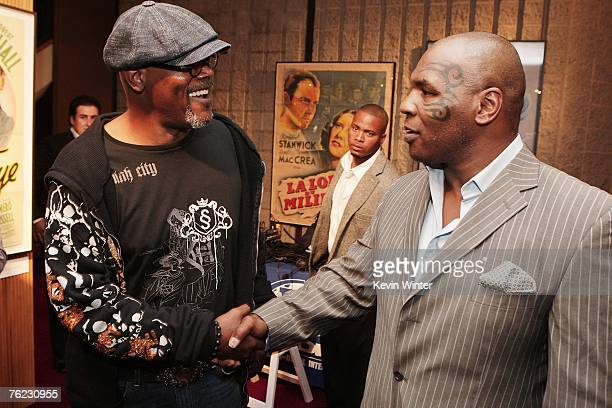 Actor Samuel L Jackson and former boxer Mike Tyson pose at the afterparty for the premiere of Yari Film's 'Resurrecting the Champ' at the Academy...