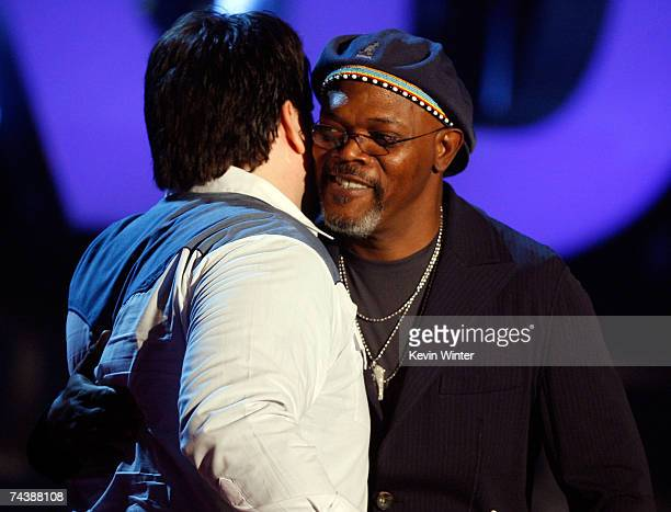 Actor Samuel L Jackson presents the award for 'Best Movie Spoof' to filmmaker Andy Signore onstage during the 2007 MTV Movie Awards held at the...