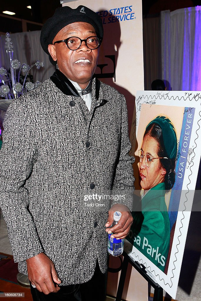 Actor Samuel L. Jackson previews the Rosa Parks Forever Stamp in the U.S. Postal Service Civil Rights Stamp Gallery backstage at the NAACP Image Awards on February 1, 2013 at The Shrine Auditorium.