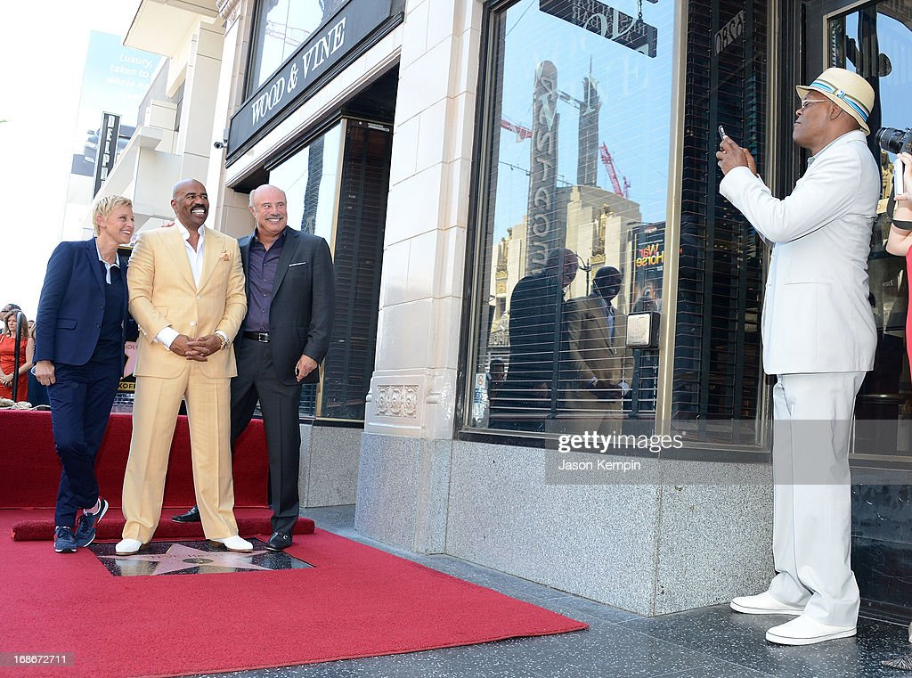Actor Samuel L Jackson (R) snaps a photo as actor and radio host <a gi-track='captionPersonalityLinkClicked' href=/galleries/search?phrase=Steve+Harvey&family=editorial&specificpeople=210865 ng-click='$event.stopPropagation()'>Steve Harvey</a> (C) poses with television personalities <a gi-track='captionPersonalityLinkClicked' href=/galleries/search?phrase=Ellen+DeGeneres&family=editorial&specificpeople=171367 ng-click='$event.stopPropagation()'>Ellen DeGeneres</a> (L) and Dr <a gi-track='captionPersonalityLinkClicked' href=/galleries/search?phrase=Phil+McGraw&family=editorial&specificpeople=234933 ng-click='$event.stopPropagation()'>Phil McGraw</a> (R) on Harvey's star on the Hollywood Walk of Fame at the star's unveiling ceremony on May 13, 2013 in Hollywood, California.