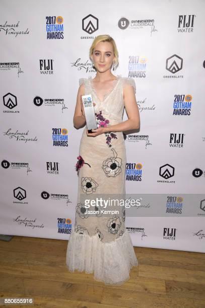 Actor Saoirse Ronan poses with the Best Actress Award at the GreenSlate Greenroom at The 2017 Gotham Awards at Cipriani Wall Street on November 27...