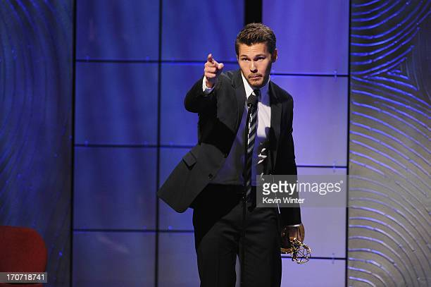 Actor Scott Clifton accepts the Outstanding Supporting Actor in a Drama Series award for 'The Bold and the Beautiful' onstage during The 40th Annual...