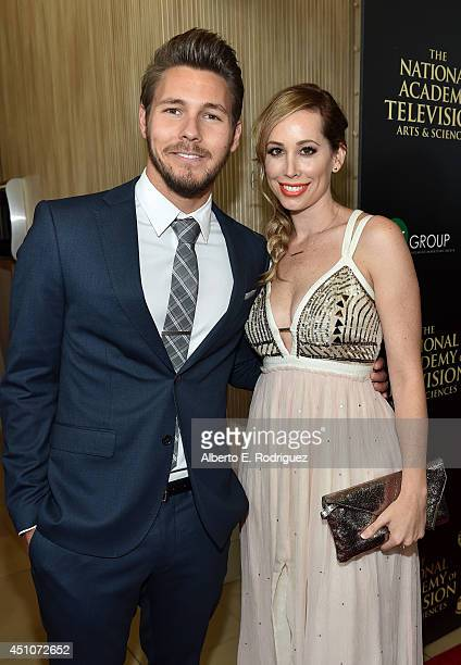 Actor Scott Clifton and Nicole Lampson attend The 41st Annual Daytime Emmy Awards at The Beverly Hilton Hotel on June 22 2014 in Beverly Hills...