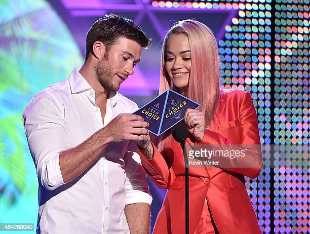 Actor Scott Eastwood and actress/singer Rita Ora speak onstage during the Teen Choice Awards 2015 at the USC Galen Center on August 16 2015 in Los...