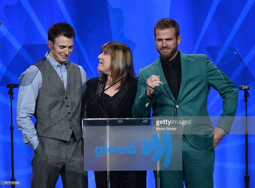 Actor <a gi-track='captionPersonalityLinkClicked' href=/galleries/search?phrase=Scott+Evans+-+Acteur&family=editorial&specificpeople=15454615 ng-click='$event.stopPropagation()'>Scott Evans</a>, mother Lisa Evans, and actor <a gi-track='captionPersonalityLinkClicked' href=/galleries/search?phrase=Chris+Evans+-+Acteur&family=editorial&specificpeople=6873149 ng-click='$event.stopPropagation()'>Chris Evans</a> attends the 24th Annual GLAAD Media Awards at JW Marriott Los Angeles at L.A. LIVE on April 20, 2013 in Los Angeles, California.