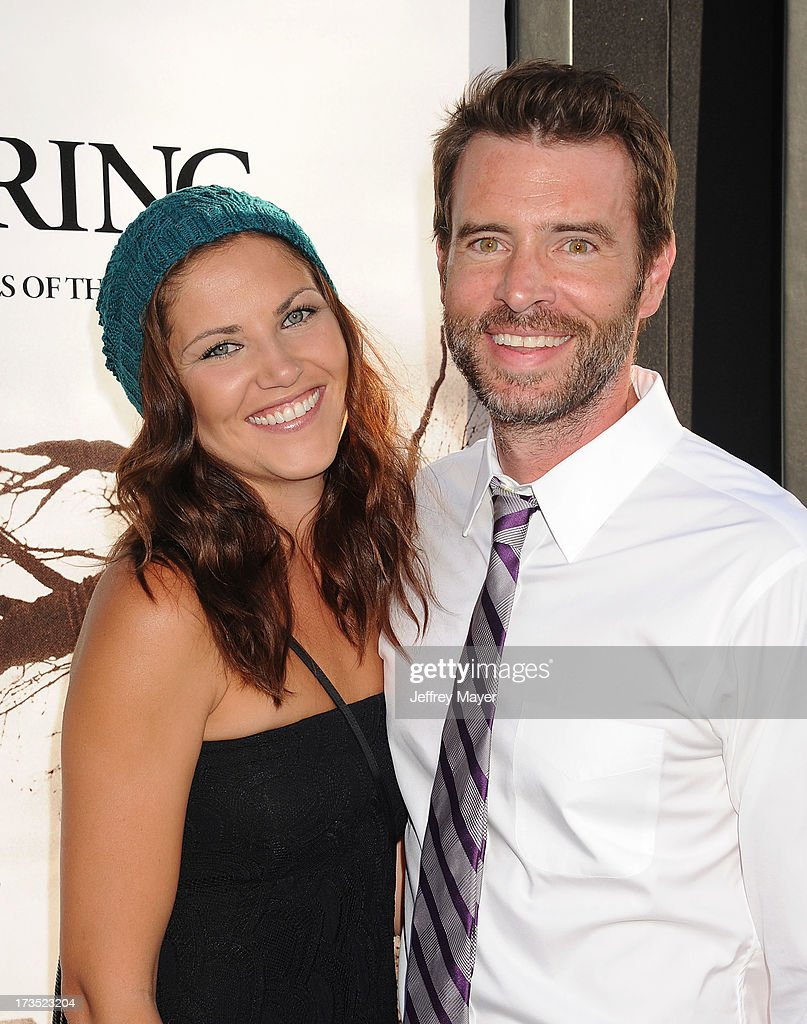 Actor Scott Foley (R) and Marika Dominczyk arrive at 'The Conjuring' Los Angeles Premiere at the ArcLight Cinemas Cinerama Dome on July 15, 2013 in Hollywood, California.