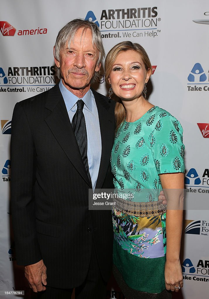 Actor <a gi-track='captionPersonalityLinkClicked' href=/galleries/search?phrase=Scott+Glenn&family=editorial&specificpeople=662450 ng-click='$event.stopPropagation()'>Scott Glenn</a> and producer Deborah Snyder attend the Arthritis Foundation 'Commitment to a Cure' 2012 Awards Gala at The Beverly Hilton Hotel on October 25, 2012 in Beverly Hills, California.