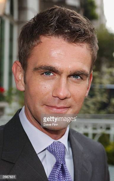 Actor Scott Maslen attends a photocall to recieve 'The Best Dressed' award at the Ritz Hotel on October 7 2003 in London