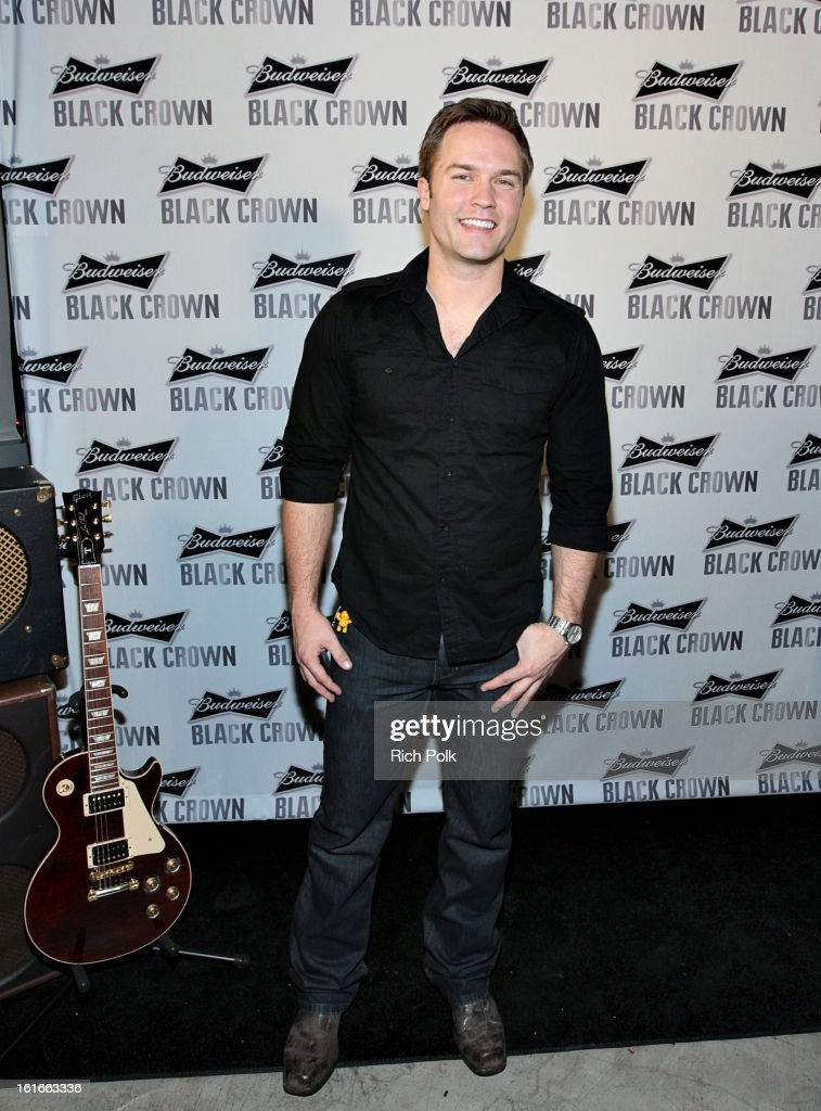 Actor Scott Porter attends the Budweiser Black Crown Launch Party at gibson/baldwin showroom on February 13, 2013 in Los Angeles, California.