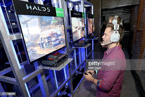 Actor Scott Porter plays Halo 5 during the Xbox One E3 Showcase Party at The Majestic Downtown on June 15 2015 in Los Angeles California