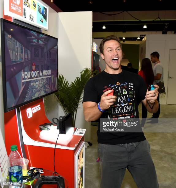 Actor Scott Porter plays Super Mario Odyssey at the Nintendo booth at the 2017 E3 Gaming Convention at Los Angeles Convention Center on June 13 2017...