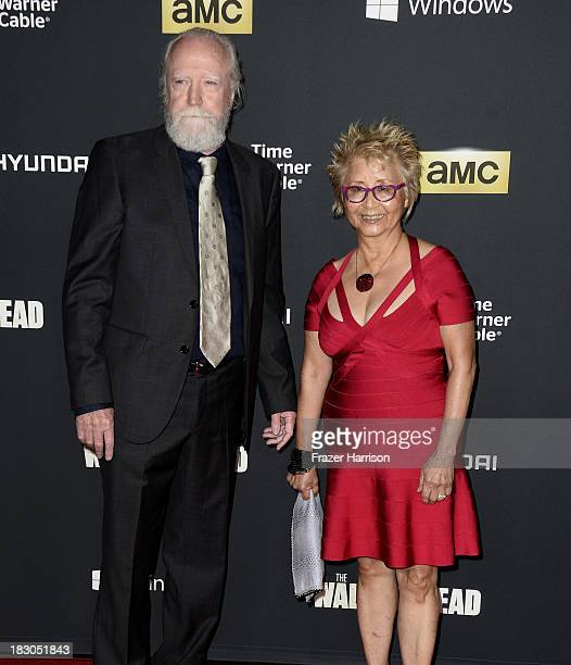 Actor Scott Wilson and Heavenly Koh Wilson arrive at the premiere of AMC's 'The Walking Dead' 4th season at Universal CityWalk on October 3 2013 in...