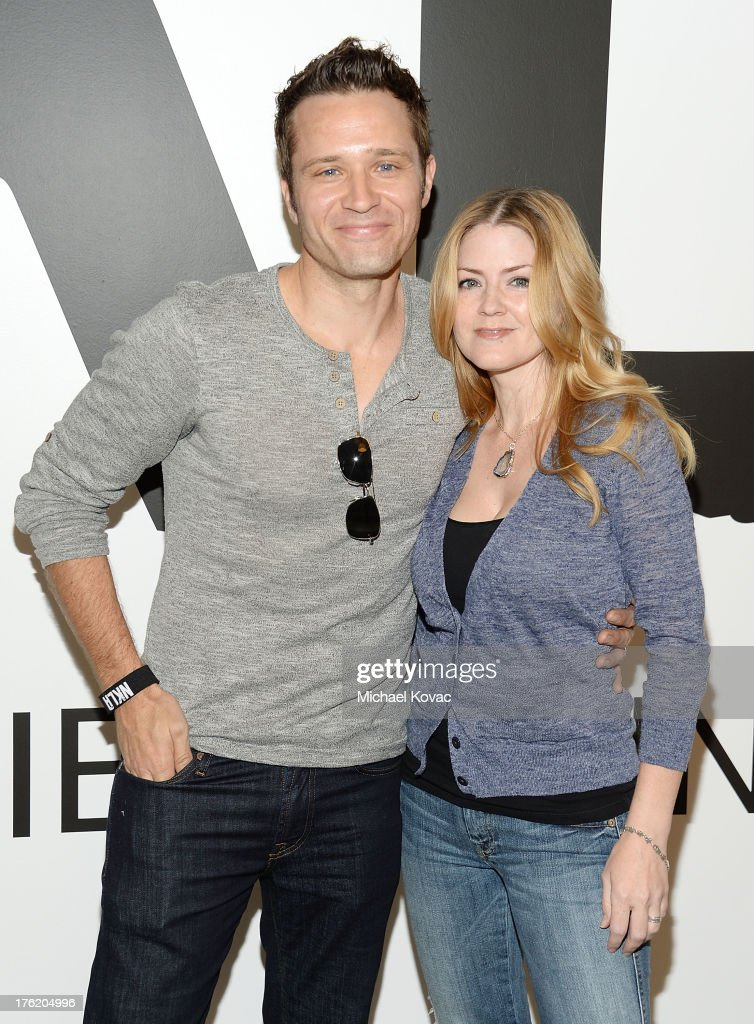 Actor Seamus Dever (L) and wife actress Juliana Dever attend the NKLA Pet Adoption Center Opening Celebration at the NKLA Pet Adoption Center on August 11, 2013 in Los Angeles, California.