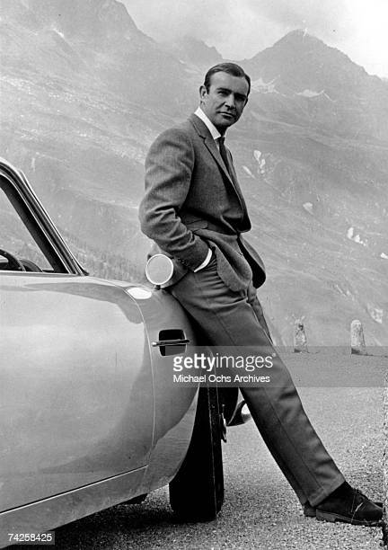 Actor Sean Connery poses as James bond next to his Aston Martin DB5 in a scene from the United Artists release 'Goldfinger' in 1964 Photo by Michael...