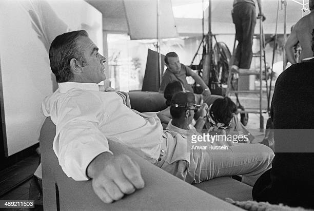 Actor Sean Connery relaxes between takes on the set of the James Bond film 'Diamonds Are Forever' USA 1971 He is on location at the Elrod House in...