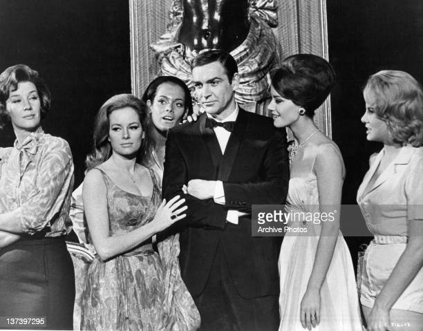 Actor Sean Connery with Lois Maxwell Luciana Paluzzi Martine Beswick Claudine Auger and Molly Peters his female costars from the film 'Thunderball'...