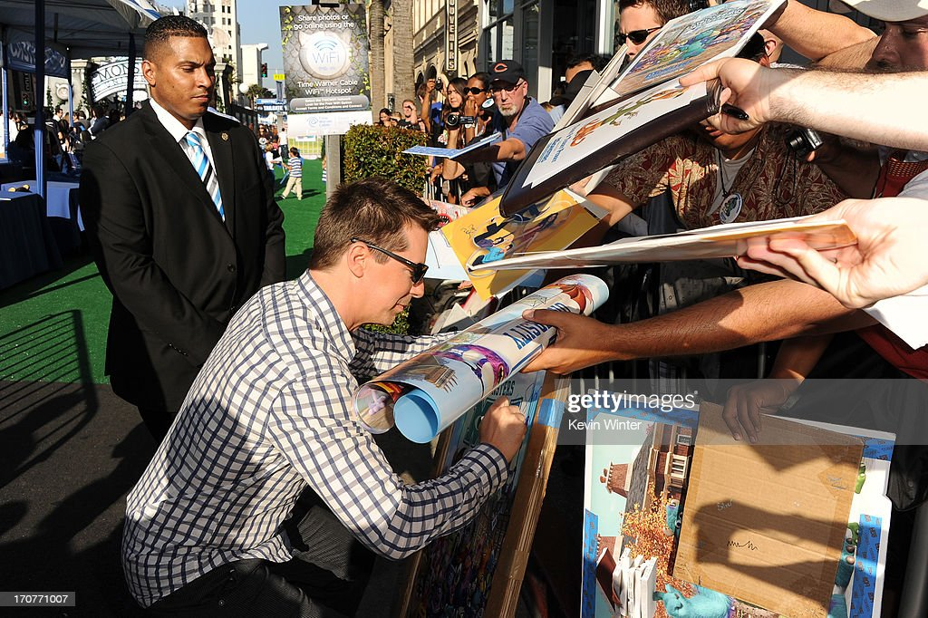 Actor <a gi-track='captionPersonalityLinkClicked' href=/galleries/search?phrase=Sean+Hayes&family=editorial&specificpeople=204240 ng-click='$event.stopPropagation()'>Sean Hayes</a> signs autographs for fans at the world premiere of Disney Pixar's 'Monsters University' at the El Capitan Theatre on June 17, 2013 in Hollywood, California.