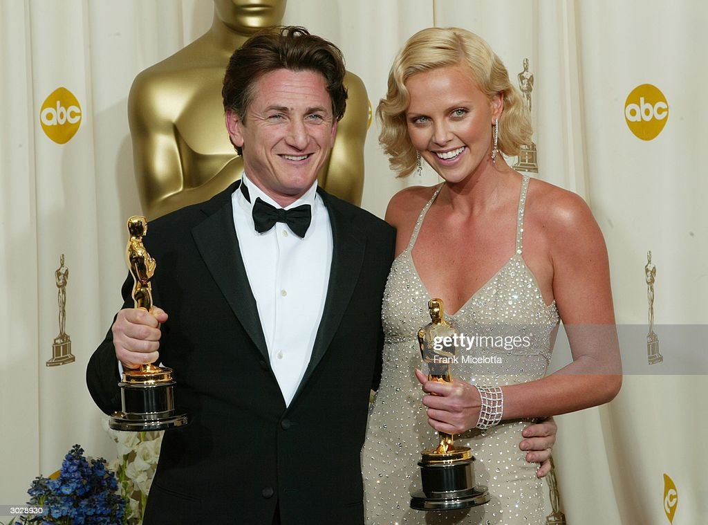 Actor Sean Penn and actress Charlize Theron pose with their Oscars after winning Best Male and Female Actors/actress during the 76th Annual Academy Awards at the Kodak Theater on February 29, 2004 in Hollywood, California.