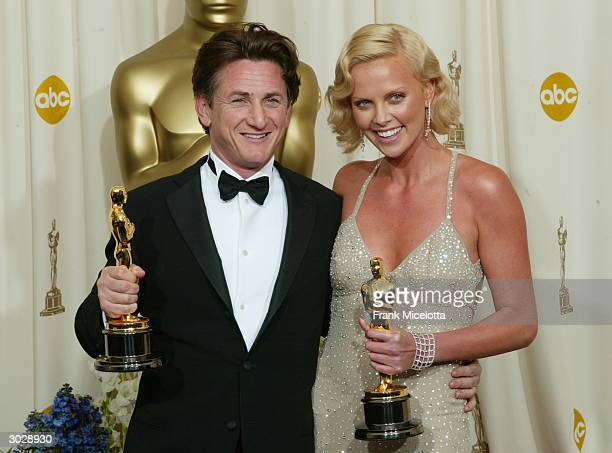 Actor Sean Penn and actress Charlize Theron pose with their Oscars after winning Best Male and Female Actors/actress during the 76th Annual Academy...