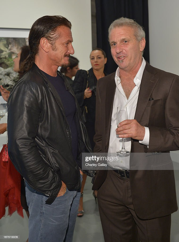 Actor <a gi-track='captionPersonalityLinkClicked' href=/galleries/search?phrase=Sean+Penn&family=editorial&specificpeople=202979 ng-click='$event.stopPropagation()'>Sean Penn</a> (L) and Photographer Jim Goldberg attend Giorgio Armani Paris Photo LA Acqua #3 at Paramount Studios on April 25, 2013 in Los Angeles, California.