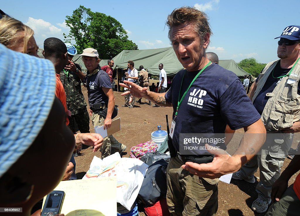 US actor Sean Penn is seen at a makeshift camp for people left homeless by the January 12 earthquake at the Petionville golf club in a suburb of...