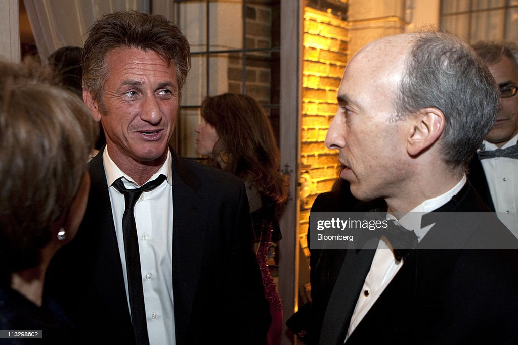 Actor <a gi-track='captionPersonalityLinkClicked' href=/galleries/search?phrase=Sean+Penn&family=editorial&specificpeople=202979 ng-click='$event.stopPropagation()'>Sean Penn</a>, left, and Gary Gensler, chairman of the Commodity Futures Trading Commission, right, attend the the Bloomberg Vanity Fair White House Correspondents' Association (WHCA) dinner afterparty in Washington, D.C., U.S., on Saturday, April 30, 2011. The dinner raises money for WHCA scholarships and honors the recipients of the organization's journalism awards. Photographer: Joshua Roberts/Bloomberg via Getty Images