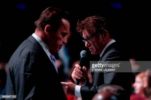 US actor Sean Penn speaks next to Former Governor of California and US actor Arnold Schwarzenegger during the One Planet Summit on December 12 at La...