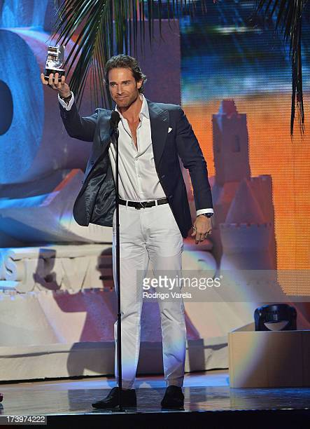 Actor Sebastian Rulli speaks onstage during the Premios Juventud 2013 at Bank United Center on July 18 2013 in Miami Florida