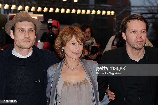 Actor Sebastian Zimmler actress Corinna Harfouch and director HansChristian Schmidt attend the 'Was Bleibt' Premiere during day six of the 62nd...