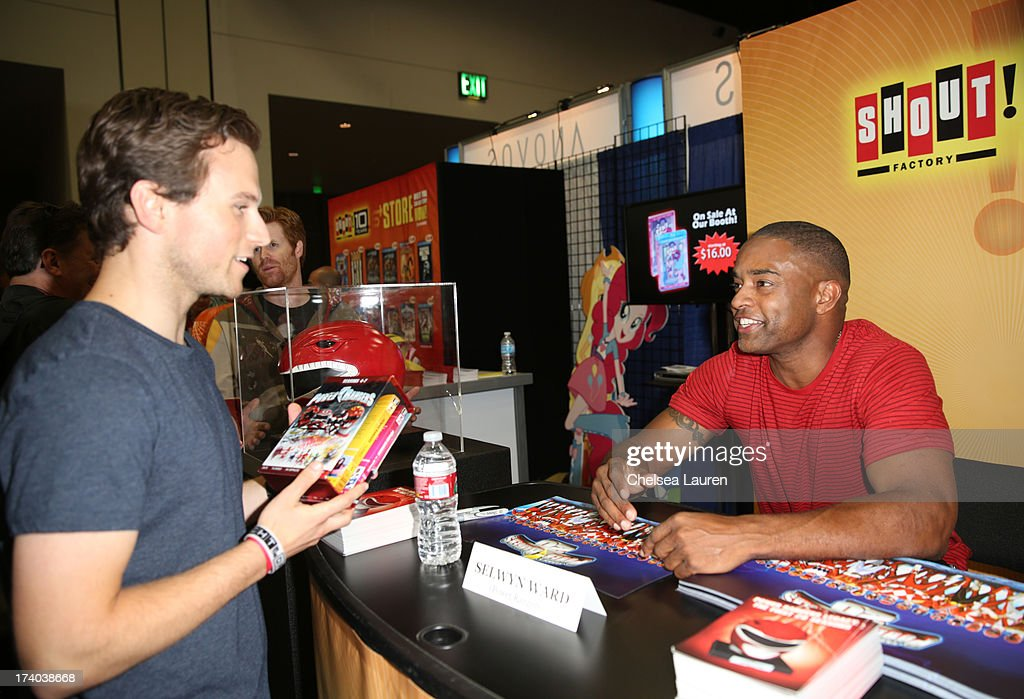 Actor Selwyn Ward, Red Ranger from Power Rangers Turbo, autographs posters for fans at the Shout Factory Booth during Comic-Con International 2013 at San Diego Convention Center on July 19, 2013 in San Diego, California.