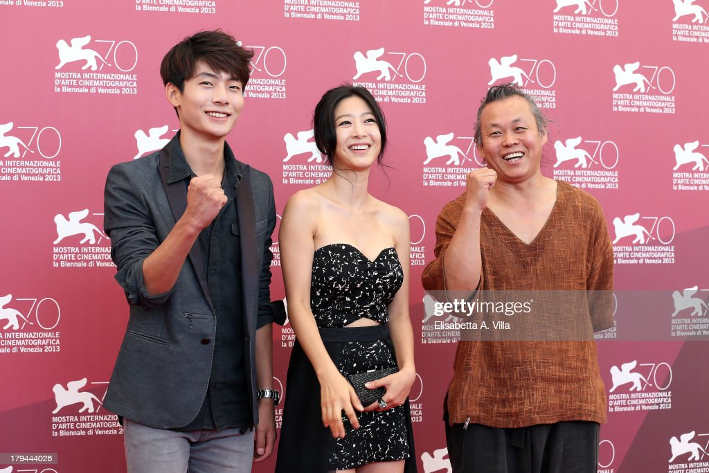 Actor Seo Young Ju, actress <a gi-track='captionPersonalityLinkClicked' href=/galleries/search?phrase=Lee+Eun-Woo&family=editorial&specificpeople=8599488 ng-click='$event.stopPropagation()'>Lee Eun-Woo</a> and director Kim Ki-duk attend the 'Moebius' Photocall during the 70th Venice International Film Festival at Sala Grande on September 3, 2013 in Venice, Italy.