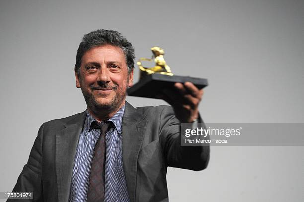 Actor Sergio Castellito poses with 'Pardo alla Carriera' during the 66th Locarno Film Festival on August 8 2013 in Locarno Switzerland